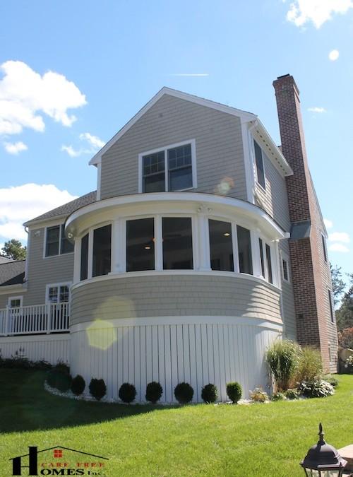 Custom designed enclosed circular porch contractor cape for Unique home additions