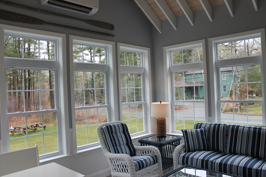 Sunroom With Exposed Rafter Ceiling Andersen Windows In
